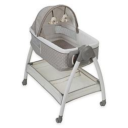 "Dream Suite™ Bassinet in Paris Measures 35"" L x 23.5"" W x"