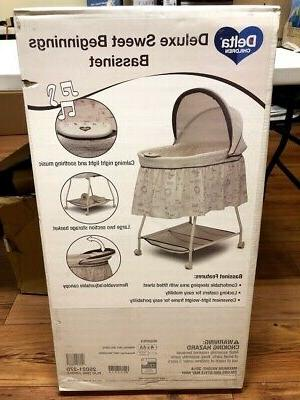 deluxe sweet beginnings bassinet playtime jungle new