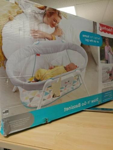 fisher price stow n go bassinet portable